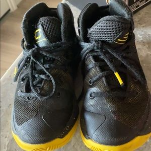Black and Yellow Under Armour shoes